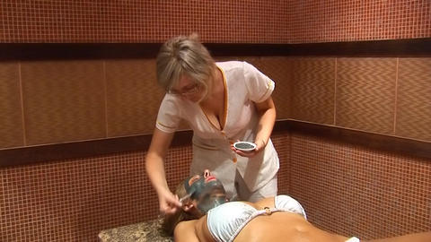 Woman puts a mud face mask с Footage