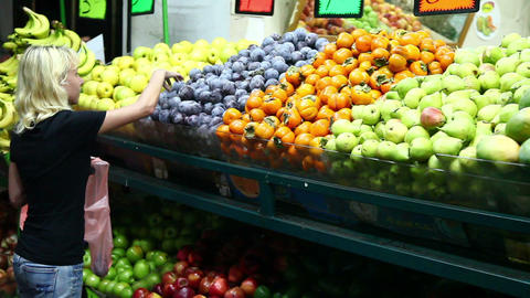 Woman Chooses Vegetables At The Market stock footage