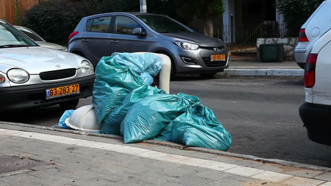 Bags of garbage on the road Stock Video Footage