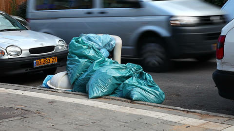 Bags Of Garbage On The Road stock footage
