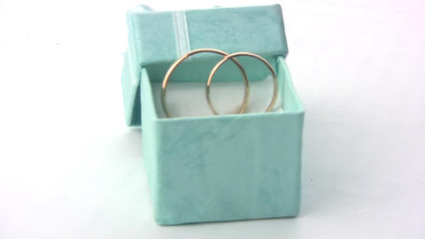 Wedding rings in a green box Footage