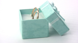 Wedding rings in a green box Stock Video Footage