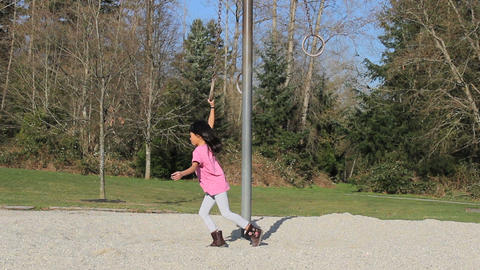 Little Asian Girl Twirling On Playground Rings Stock Video Footage