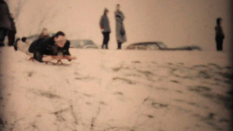 Man Having Fun Sledding In Winter 1957 Vintage 8mm film Stock Video Footage