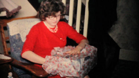 Pretty Girl In Red Dress Opening Christmas Gifts 1957... Stock Video Footage