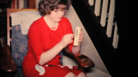 Pretty Girl In Red Dress Opening Christmas Gifts 1957 Vintage 8mm film Footage