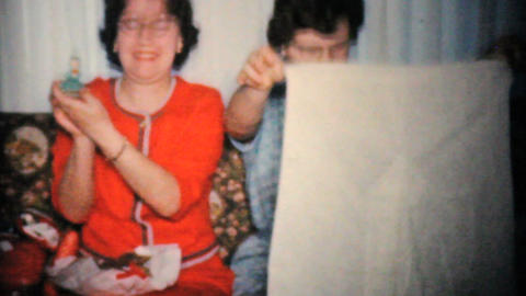 Sisters Opening Christmas Presents 1960 Vintage 8mm film Stock Video Footage