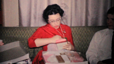 Woman Gets New Purse For Christmas 1957 Vintage 8mm film Stock Video Footage