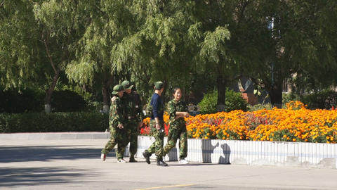 Four Chinese Students in Army Uniform Walking Footage