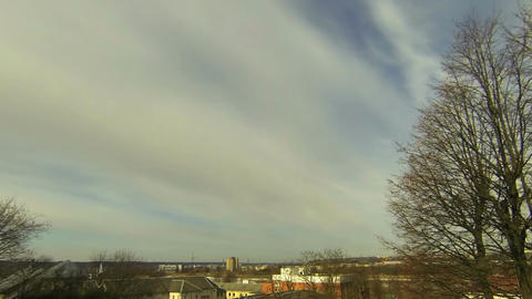 Time-lapse of midday clouds over the city 1 Footage