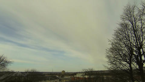 Time-lapse of midday clouds over the city 1 Stock Video Footage