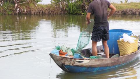 Fisherman pulling in his net Footage