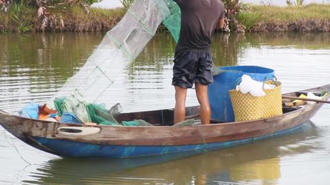 Fisherman pulling in his net Stock Video Footage