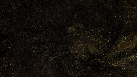 Starry gold dust. Abstract dark current and glimpses on a dark background Live Action