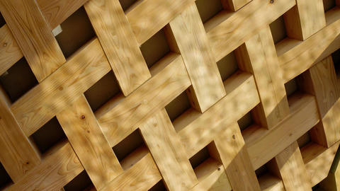 Light reflected from the water surface reflected on the Wood lattice wall Live Action