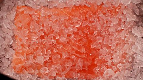 Timelapse of melting ice around fresh raw piece of salmon. Fresh salmon fillet Live Action
