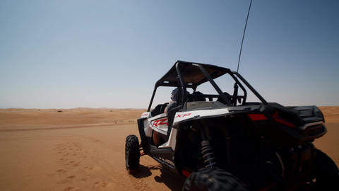 Sand buggy driving in the desert. Fast offroad vehicle driving on the sand dunes Live Action