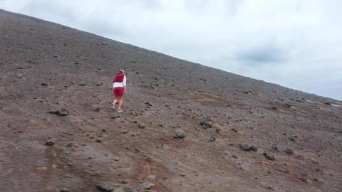 Male traveler enjoying journey on Capelinhos Volcano, Faial Island, Azores Live Action