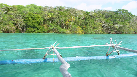 Traditional pirogue tour in the scenic Upi bay, Isle of Pines. New Caledonia Live Action
