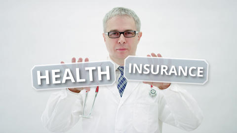Doctor holds HEALTH INSURANCE words in his hands Live Action