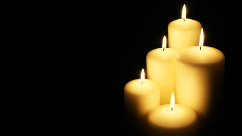 Five Flickering Candles On The Black Background stock footage