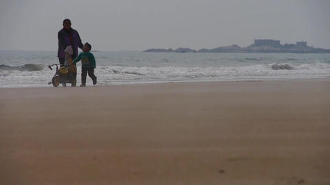 mother playing with kid on seaside Stock Video Footage