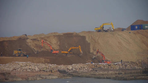 Excavator working & dumper truck on construction site... Stock Video Footage
