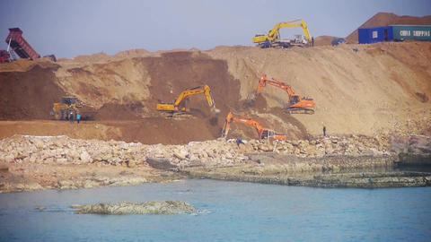 Excavator working & dumper truck on construction site... Stock Video Footage