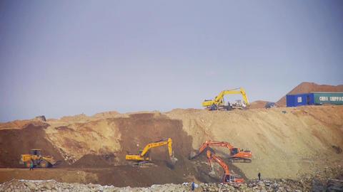 excavator working & dumper truck on construction site Footage