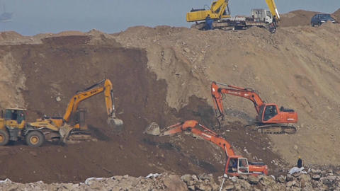 excavator working & dumper truck on construction site Footage