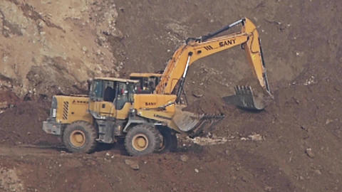 timelapse excavator working & dumper truck on... Stock Video Footage