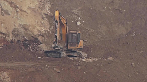 timelapse excavator working & dumper truck on construction site Footage