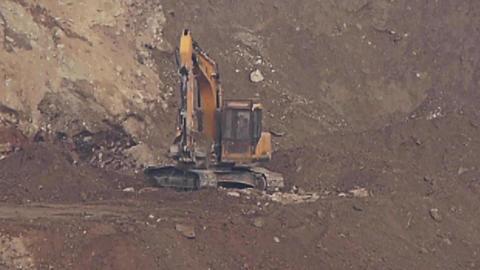 timelapse excavator working & dumper truck on... Stock Video Footage
