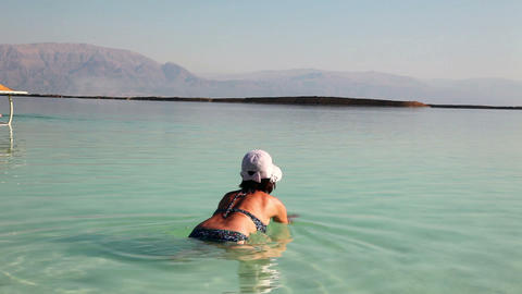 Woman on the Dead Sea Stock Video Footage