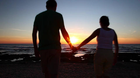Man and woman admiring the sunset Stock Video Footage