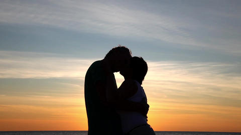 Couple kissing on beach Stock Video Footage