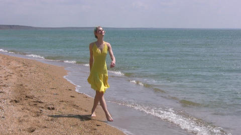 Girl goes to the beach Stock Video Footage