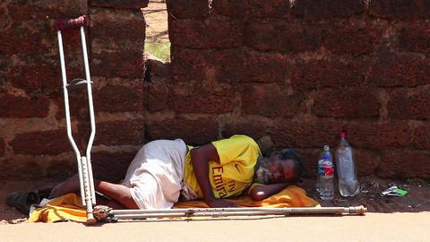 Homeless man sleeping on the ground Stock Video Footage