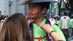 Girl is fixing the hat of a young boy during the N Stock Video Footage