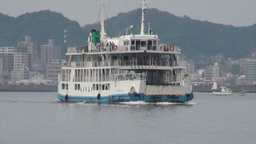 Sailing Japanese ferry with Kagoshima city in the  Footage