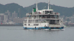 Sailing Japanese ferry with Kagoshima city in the Stock Video Footage
