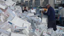 Recycling foam boxes at the Tsukiji fish market in Footage