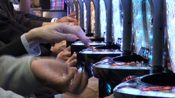 Throwing balls into slot machine in Japanese gambl Stock Video Footage