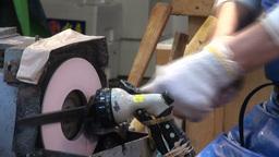 Closeup of knife sharpening at the Tsukiji fish ma Stock Video Footage
