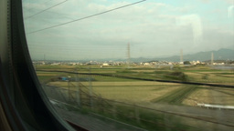 Riding the Shinkansen through rural landscape in J Stock Video Footage