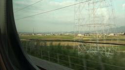Riding the Shinkansen through rural landscape in J Stock Video Footage