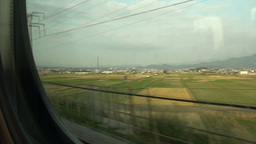 Riding the Shinkansen through rural landscape in J Footage