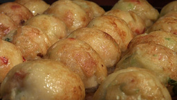 Takoyaki ('octopus balls') being prepared in a Jap Stock Video Footage