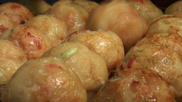 Takoyaki ('octopus balls') being prepared in a Jap Footage
