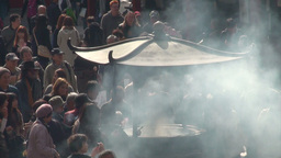 Incense burning urn and crowd gathering at Sensoji Footage